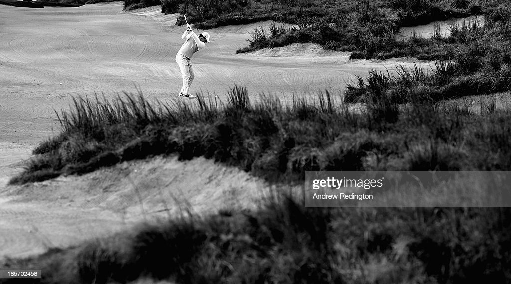 Rory McIlroy of Northern Ireland hits his second shot on the 14th hole during the first round of the BMW Masters at Lake Malaren Golf Club on October 24, 2013 in Shanghai, China.