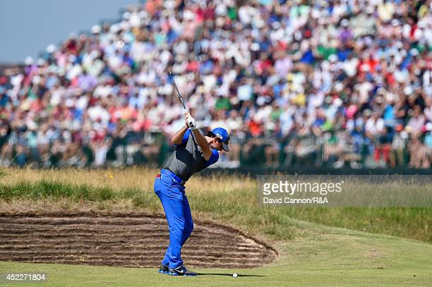 Rory McIlroy of Northern Ireland hits his second shot on the 14th hole during the first round of The 143rd Open Championship at Royal Liverpool on...