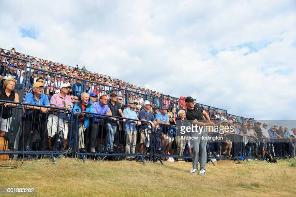 Rory McIlroy of Northern Ireland hits his second shot on the 16th hole during the first round of the 147th Open Championship at Carnoustie Golf Club...