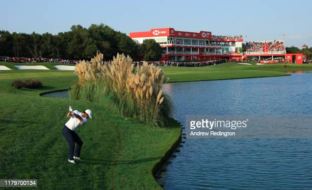 Rory McIlroy of Northern Ireland hits his second shot on the 18th hole during Day Four of the WGC HSBC Champions at Sheshan International Golf Club...