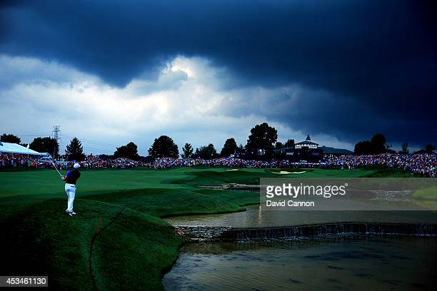 Rory McIlroy of Northern Ireland hits his second shot on the 18th hole during the final round of the 96th PGA Championship at Valhalla Golf Club on...
