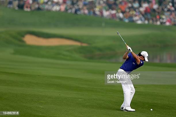 Rory McIlroy of Northern Ireland hits his second shot on the ninth hole during the final round of the BMW Masters at the Lake Malaren Golf Club on...