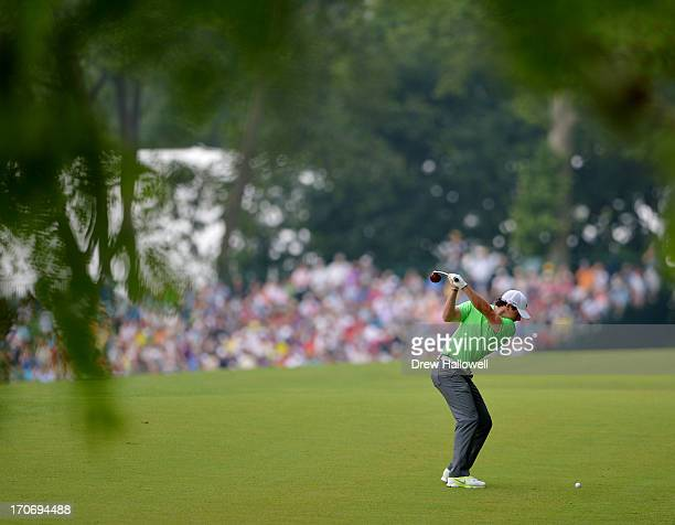 Rory McIlroy of Northern Ireland hits his second shot on the second hole during the final round of the 113th U.S. Open at Merion Golf Club on June...