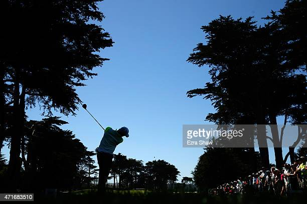 Rory McIlroy of Northern Ireland hits his tee shot on the fourth hole during round two of the World Golf Championship Cadillac Match Play at TPC...