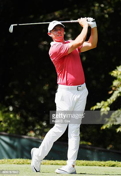 Rory McIlroy of Northern Ireland hits his tee shot on the second hole during the first round of the TOUR Championship By CocaCola at East Lake Golf...