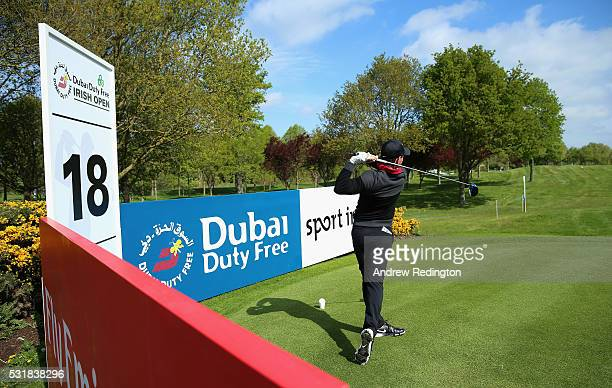 Rory McIlroy of Northern Ireland hits his teeshot on the 18th hole during practice for the Dubai Duty Free Irish Open Hosted by the Rory Foundation...