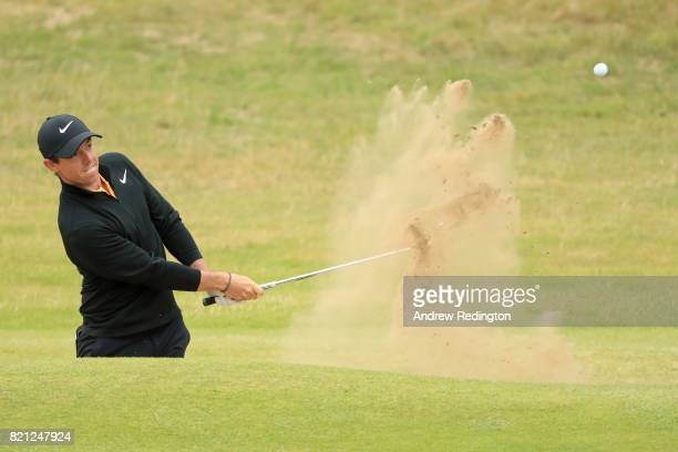 Rory McIlroy of Northern Ireland hits his third shot from a bunker on the 18th hole during the final round of the 146th Open Championship at Royal...