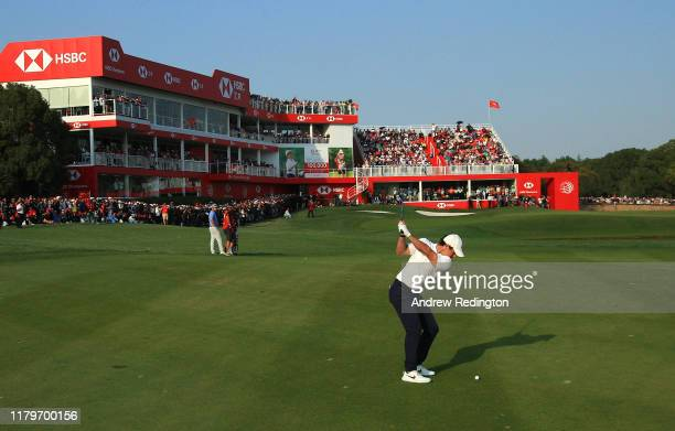 Rory McIlroy of Northern Ireland hits his third shot on the 18th hole during Day Four of the WGC HSBC Champions at Sheshan International Golf Club on...