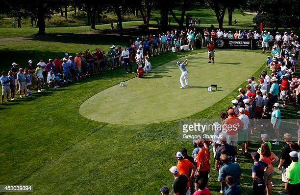 Rory McIlroy of Northern Ireland hits off the 14th tee during the second round of the World Golf ChampionshipsBridgestone Invitational at Firestone...