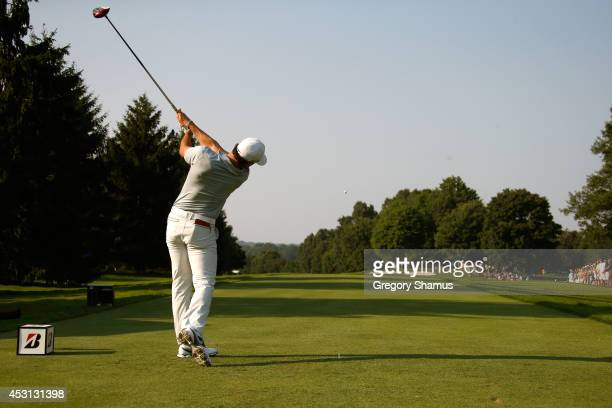 Rory McIlroy of Northern Ireland hits off the 16th tee during the final round of the World Golf Championships-Bridgestone Invitational at Firestone...