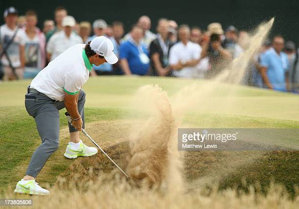 Rory McIlroy of Northern Ireland hits out of a bunker on the 5th hole during the first round of the 142nd Open Championship at Muirfield on July 18,...