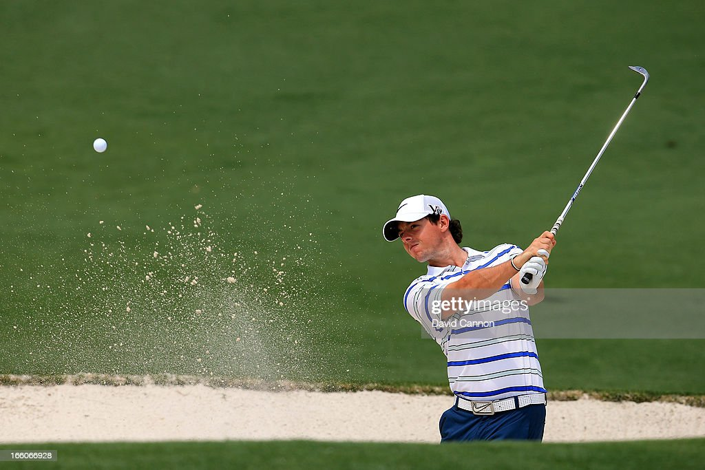 Rory McIlroy of Northern Ireland hits out of the bunker during a practice round prior to the start of the 2013 Masters Tournament at Augusta National Golf Club on April 8, 2013 in Augusta, Georgia.