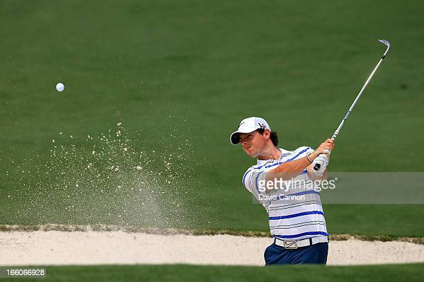 Rory McIlroy of Northern Ireland hits out of the bunker during a practice round prior to the start of the 2013 Masters Tournament at Augusta National...