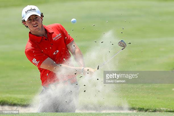 Rory McIlroy of Northern Ireland hits out of the sand on the fourth hole during the Final Round of the 94th PGA Championship at the Ocean Course on...