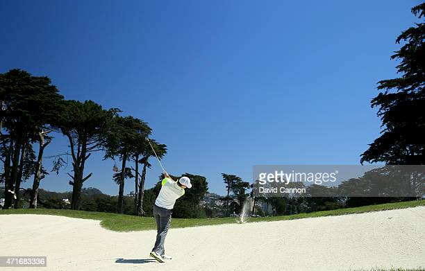 Rory McIlroy of Northern Ireland hits the lip of the bunker with his second shot on the par 5, first hole during round two of the World Golf...