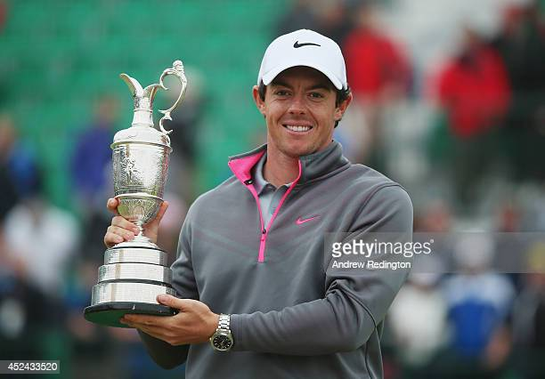 Rory McIlroy of Northern Ireland holds the Claret Jug after his twostroke victory at The 143rd Open Championship at Royal Liverpool on July 20 2014...