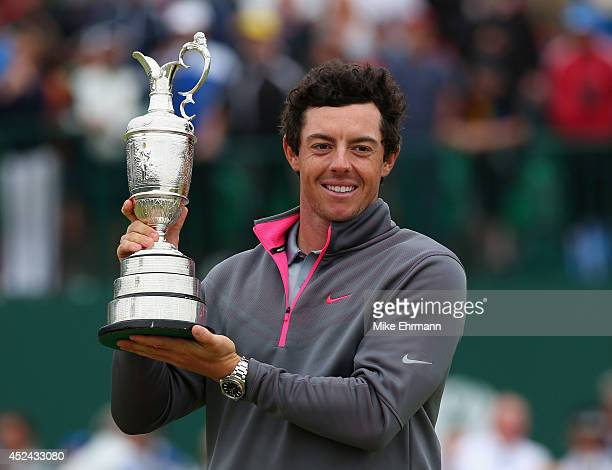 Rory McIlroy of Northern Ireland holds the Claret Jug aloft after his twostroke victory at The 143rd Open Championship at Royal Liverpool on July 20...