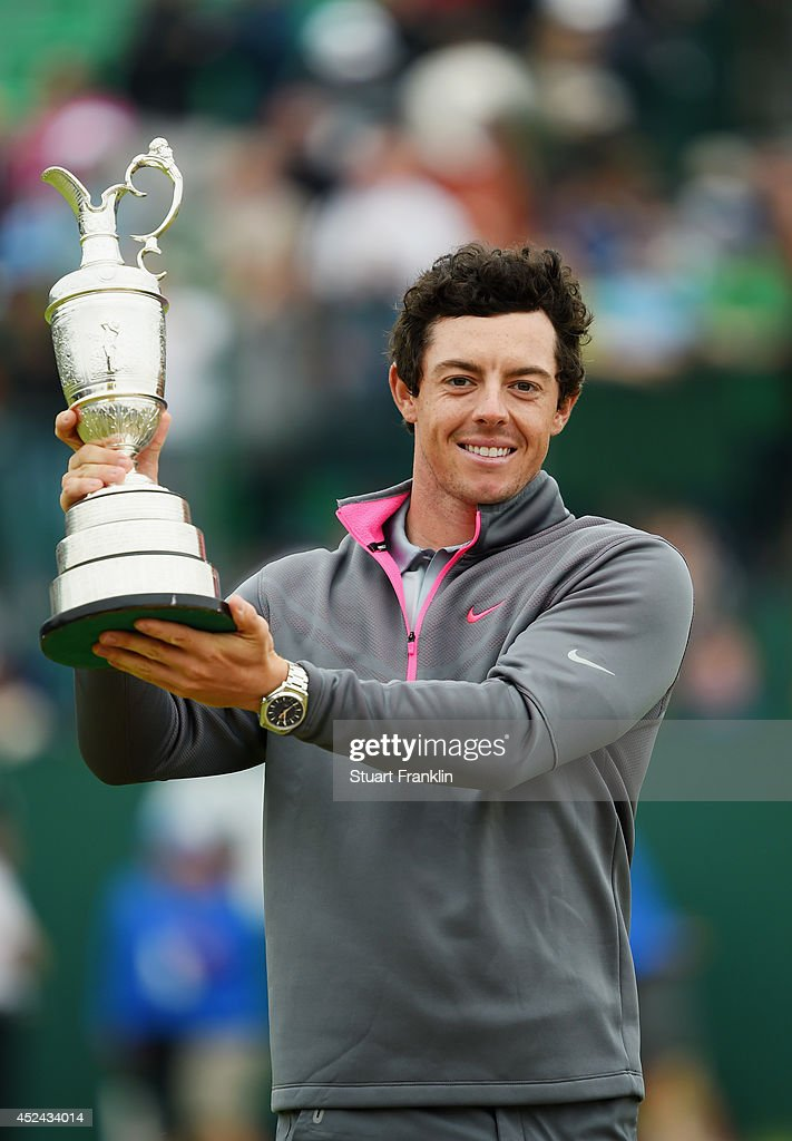 Rory McIlroy of Northern Ireland holds the Claret Jug aloft after his two-stroke victory at The 143rd Open Championship at Royal Liverpool on July 20, 2014 in Hoylake, England.