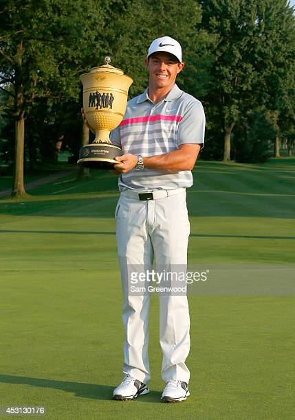 Rory McIlroy of Northern Ireland holds the Gary Player Cup trophy after winning the World Golf Championships-Bridgestone Invitational with a score of...