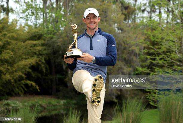 Rory McIlroy of Northern Ireland holds the new Players Championship trophy after his one shot win during the final round of The Players Championship...