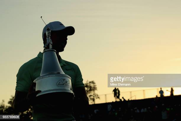 Rory McIlroy of Northern Ireland holds the trophy after his two shot victory during the final round at the Arnold Palmer Invitational Presented By...