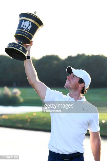Rory McIlroy of Northern Ireland holds the trophy aloft after his victory in a playoff during Day Four of the WGC HSBC Champions at Sheshan...
