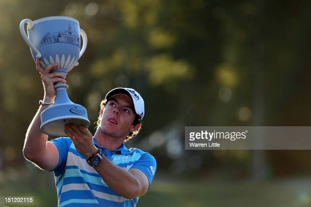 Rory McIlroy of Northern Ireland holds up the trophy after winning the Deutsche Bank Championship at TPC Boston on September 3 2012 in Norton...