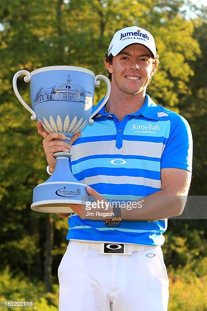 Rory McIlroy of Northern Ireland holds up the trophy after winning the Deutsche Bank Championship at TPC Boston on September 3, 2012 in Norton,...