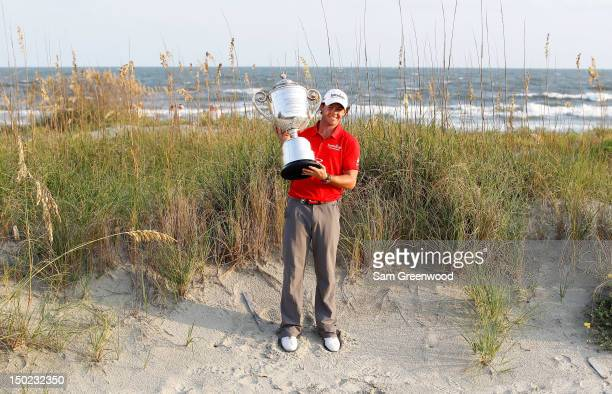 Rory McIlroy of Northern Ireland holds up the Wanamaker Trophy after winning the 94th PGA Championship at the Ocean Course on August 12, 2012 in...