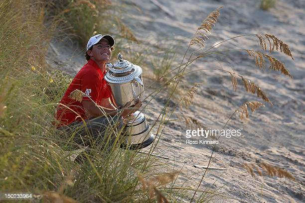 Rory McIlroy of Northern Ireland holds up the Wanamaker Trophy after winning the 94th PGA Championship at the Ocean Course on August 12 2012 in...