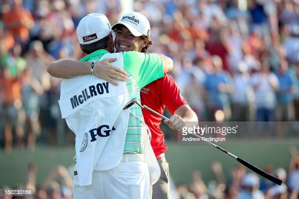 Rory McIlroy of Northern Ireland hugs his caddie J.P. Fitzgerald after winning the 94th PGA Championship at the Ocean Course on August 12, 2012 in...