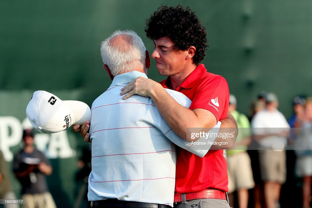 Rory McIlroy of Northern Ireland hugs his father Gerry McIlroy after winning the 94th PGA Championship at the Ocean Course on August 12, 2012 in Kiawah Island, South Carolina.