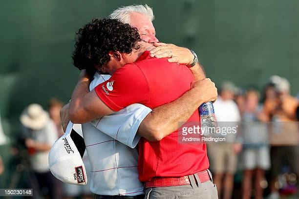 Rory McIlroy of Northern Ireland hugs his father Gerry McIlroy after winning the 94th PGA Championship at the Ocean Course on August 12, 2012 in...