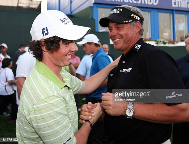Rory McIlroy of Northern Ireland is congratulated by Darren Clarke of Northern Ireland after the of final round of the Dubai Desert Classic played on...