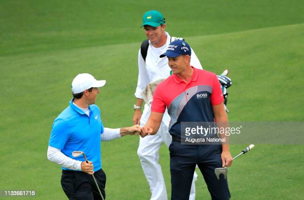 Rory McIlroy of Northern Ireland is congratulated by Henrik Stenson of Sweden after McIlroy's eagle on No 8 during the third round of the Masters at...