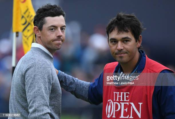 Rory McIlroy of Northern Ireland is consoled by his caddy Harry Diamond on the eighteenth hole during the second round of the 148th Open Championship...
