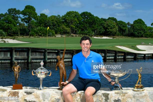 Rory McIlroy of Northern Ireland is named the 2019 PGA TOUR Player of the Year McIlroy poses with his trophies during the Player of the Year ceremony...