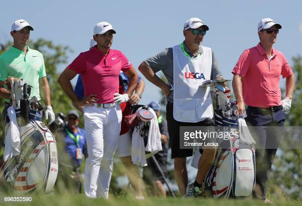 Rory McIlroy of Northern Ireland Jason Day of Australia and Justin Rose of England wait at the 14th tee during the first round of the 2017 US Open at...