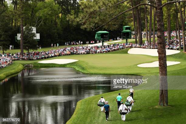 Rory McIlroy of Northern Ireland Jon Rahm of Spain and Adam Scott of Australia walk to the 16th green during the second round of the 2018 Masters...