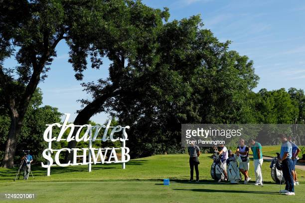 Rory McIlroy of Northern Ireland, Jon Rahm of Spain and Brooks Koepka of the United States take part in a moment of silence held in place of the 8:46...