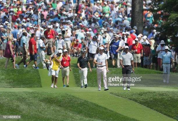 Rory McIlroy of Northern Ireland Justin Thomas of the United States and Tiger Woods of the United States walk on the sixth hole during the second...