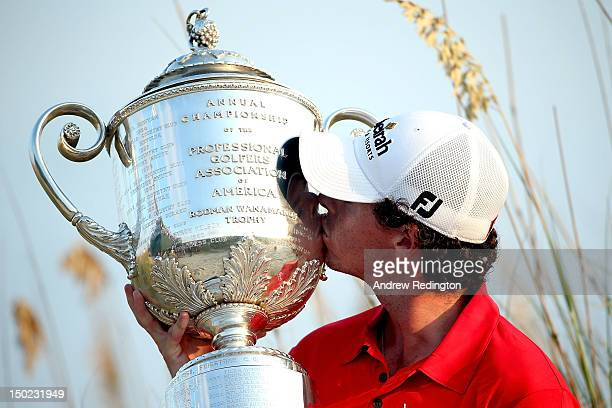 Rory McIlroy of Northern Ireland kisses the Wanamaker Trophy after winning the 94th PGA Championship at the Ocean Course on August 12 2012 in Kiawah...