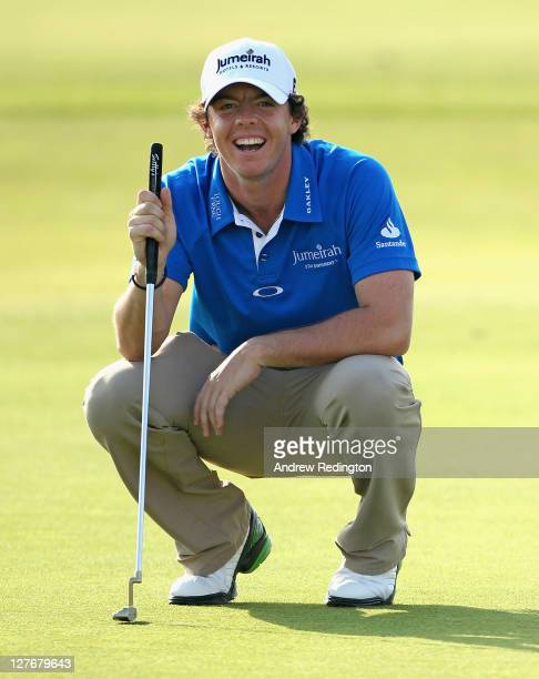Rory McIlroy of Northern Ireland laughs as he lines up a putt on the 18th hole during the second round of The Alfred Dunhill Links Championship at...