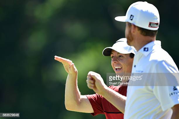 Rory McIlroy of Northern Ireland laughs with Jimmy Walker of the United States during a practice round prior to the 2016 PGA Championship at...