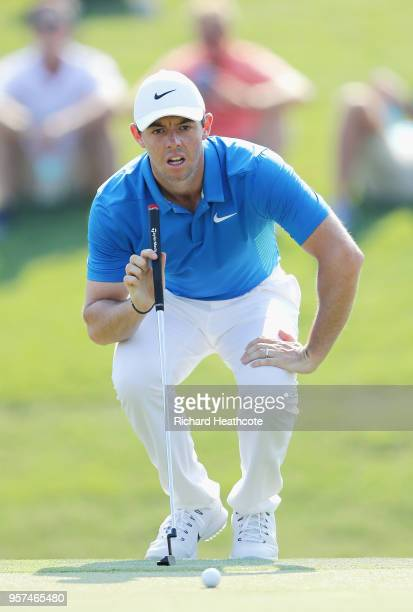 Rory McIlroy of Northern Ireland lines up a putt on the 12th green during the second round of THE PLAYERS Championship on the Stadium Course at TPC...