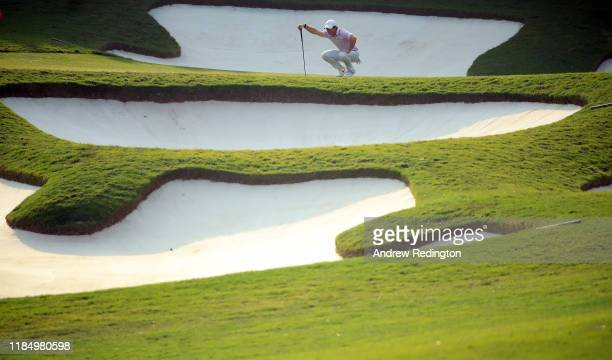 Rory McIlroy of Northern Ireland lines up a putt on the 15th hole during Day Three of the WGC HSBC Champions at Sheshan International Golf Club on...