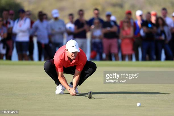 Rory McIlroy of Northern Ireland lines up a putt on the 16th green during round three of the Abu Dhabi HSBC Golf Championship at Abu Dhabi Golf Club...