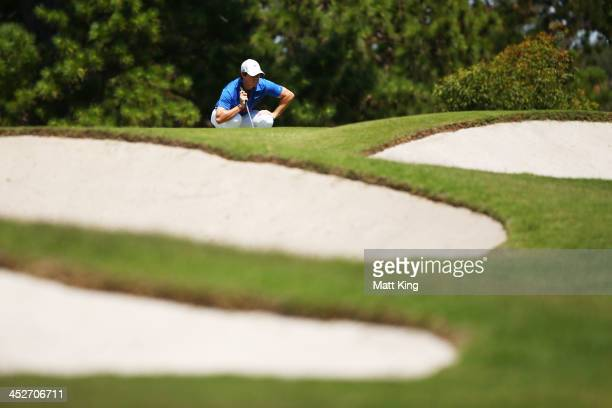 Rory McIlroy of Northern Ireland lines up a putt on the 8th green during day four of the 2013 Australian Open at Royal Sydney Golf Club on December 1...
