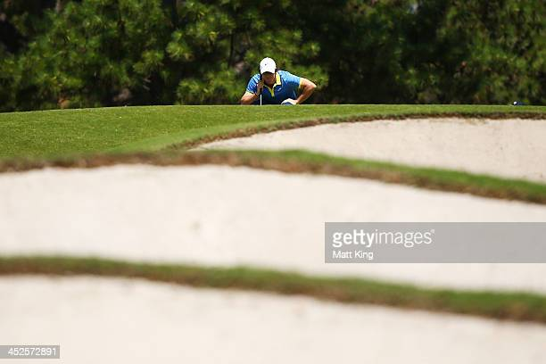 Rory McIlroy of Northern Ireland lines up a putt on the 8th hole during day three of the Australian Open at Royal Sydney Golf Club on November 30...