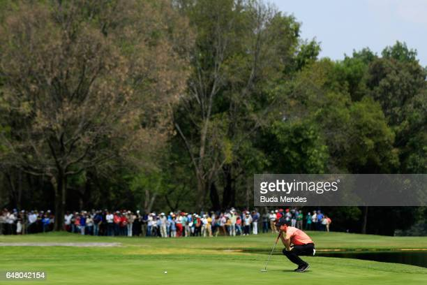 Rory McIlroy of Northern Ireland lines up a putt on the on the sixth hole during the third round of the World Golf Championships Mexico Championship...